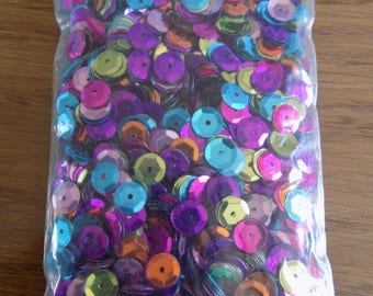 Bag of brightly colored sequins
