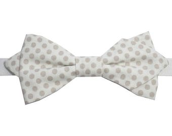 Taupe white polka dot bow with sharp edges