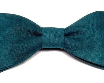 Teal bow sewn by hand with straight edges