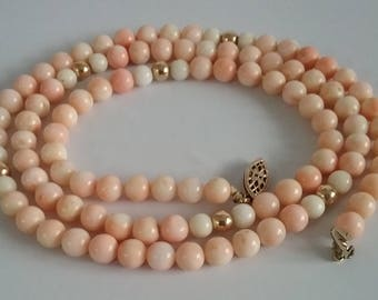 Vintage natural color pink coral necklace.