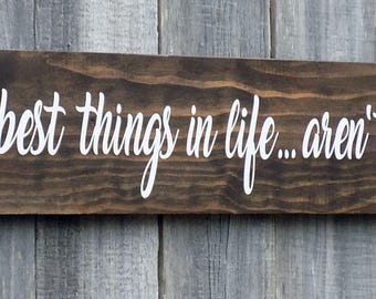 The best things in life...aren't things, Kona brown stain, made from reclaimed wood, 22 inches by 4 1/2 inches.