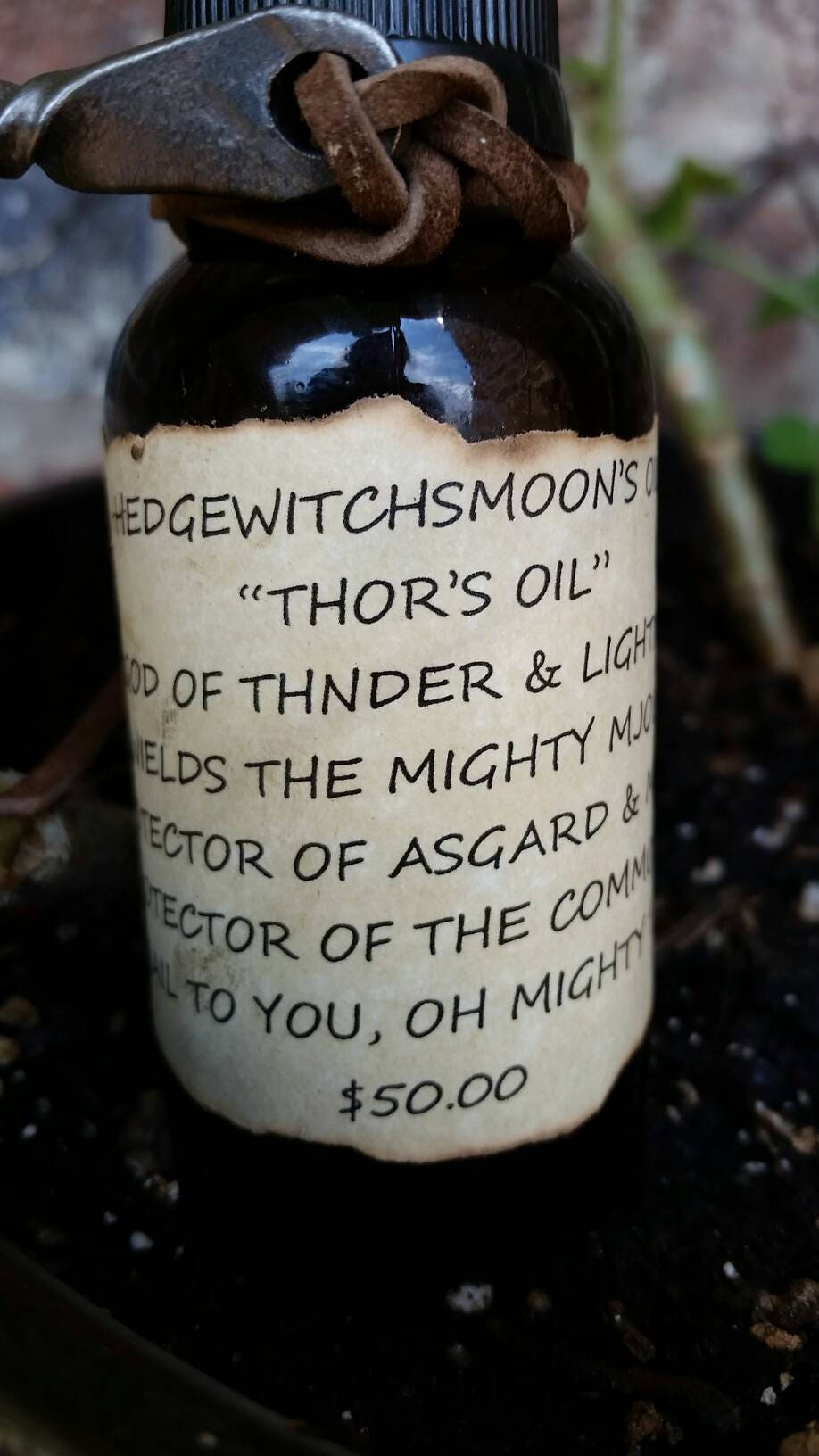 4 oz thor s oil w mjolnir attached yes thor s hammer is included