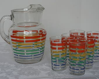 Colorful vintage tumblers and pitcher