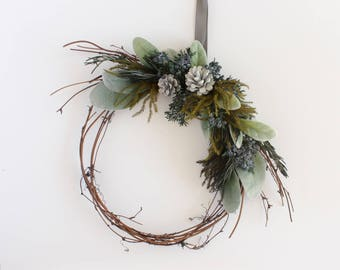 Winter Grapevine Wreath, Boho Woodland Christmas Holiday Pine Cone Evergreen Wreath with Frosted Leaves, Thin Branch Wreath, 9 Inch Wreath