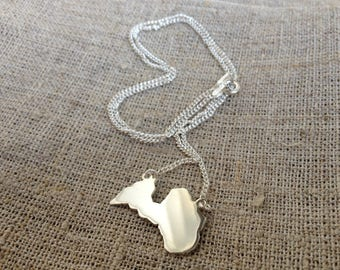 Silver necklace with pendant of Latvian contour