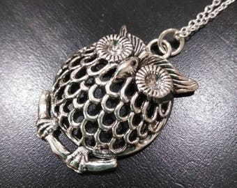 Silver owl sitting on a limb on a sterling silver chain
