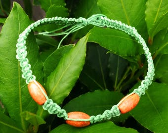 Green and orange knotted hemp bracelet