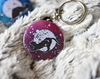 Keychain with a black cat on purple background