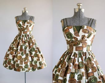 Vintage 1950s Dress / 50s Cotton Dress / Brown and Green Novelty Print Dress w/ Shelf Bust S