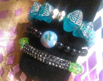 3 piece Turquoise Art beaded bracelet with silver beads, Green Shimmery bracelet and black bracelet with earth design.