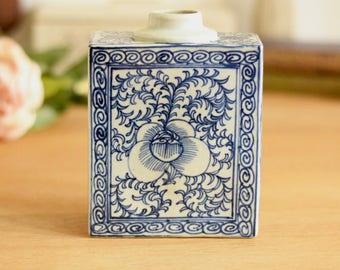 Blue and white bottle or vase, oriental patterned vintage ceramic.