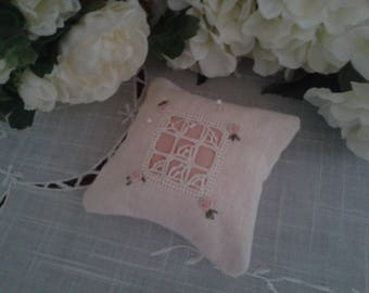 small embroidered pincushion