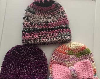 Homemade crocheted baby girl hats