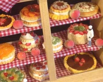 Gullivers world bakery counter, dollhouse miniature ,dollhouse food,handmade, one inch scale, dolls house miniature x
