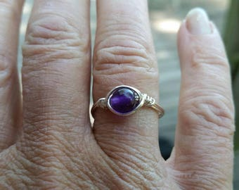 Wire wrapped amethyst bead ring in silver filled wire