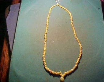 String of genuine Ancient Roman yellow glass beads circa 100-400 AD.
