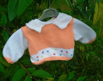 baby 3 months in orange and white sweater