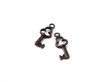 Set of 2 red copper color key charms
