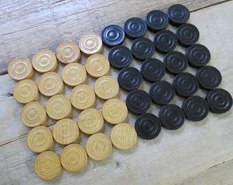 Lot of 40 vintage wooden checkers, game pieces.