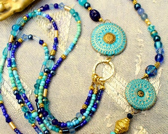 Long indian medallion and multi-rows necklace. Turquoise indigo gold. Polymer, agates, glass beads, howlite, gilded metal.Creating designer.