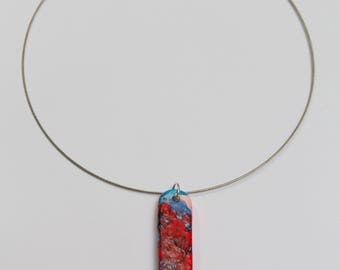 Fimo pendant necklace, decorated in red and blue