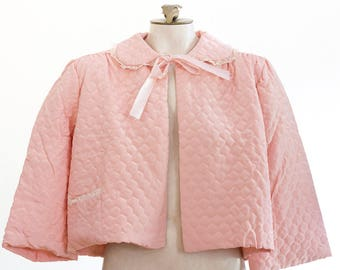 1950s pink quilted bed jacket with 3/4 length sleeves