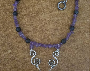 Amethyst and black bead necklace with tribal pendant