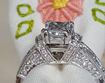 Custom made 18k white gold diamond ring with a GIA certified princess cut diamond with round and princess cut genuine natural diamonds