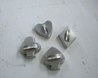 Set of cookie cutters, diamond, spade, heart, club