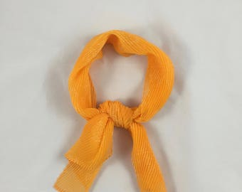 Vintage retro orange pleated scarf with white flower print