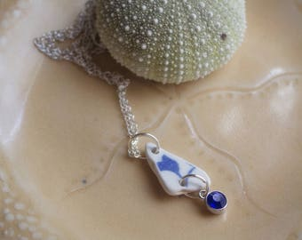 Blue beach pottery necklace with flower design and September birthstone blue rhinestone charm