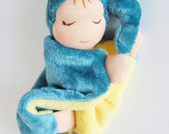 Doll in cotton and minkee blanket.
