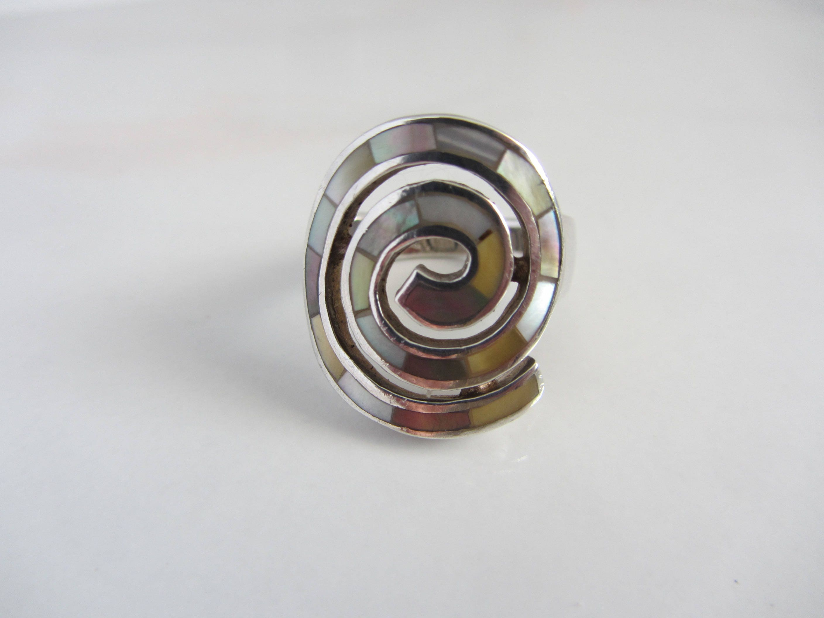 sterling silver spiral ring with inlay abalone and iridescent
