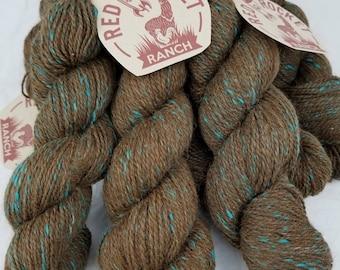 Brown and turquoise blended huacaya alpaca yarn