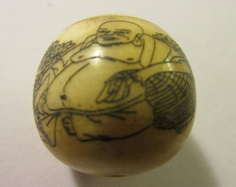Chinese Round Focal Bone Bead Etched with a Monk and His Sutras, 1""