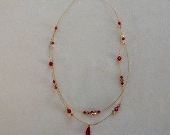 Necklace with red swarovski crystals mounted on double row of gold wire and Crystal pendant.