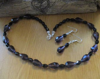 Necklace and Earring Matching Set with Purple Faceted Glass Teardrops and Black Oval Faceted Glass Beads