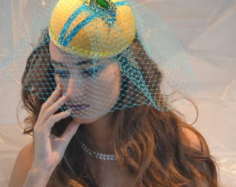 Yellow fascinator with turquois flower brooch