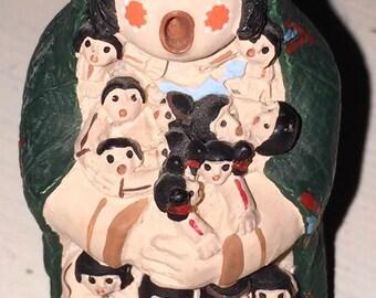 Vintage Native American Jemez Story Teller figurine I read that the more children on her the better story teller she is
