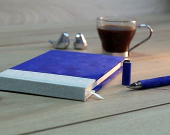 Beautiful hand made notebook with matching pen.