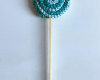 Green and blue crochet lollypop