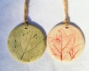 choose one handmade pottery Christmas ornament of white oak leaves, red ornament, green ornament, ceramic leaf ornament, tree ornament