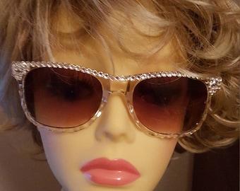 Sparkling translucent glamour sunglasses adorned with Swarovski