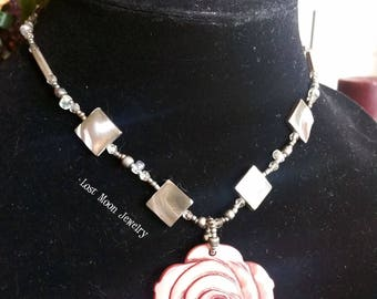 Carved rose shell pendant necklace with matching earrings