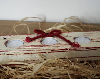 Wooden candle holder decorated with shabby chic method