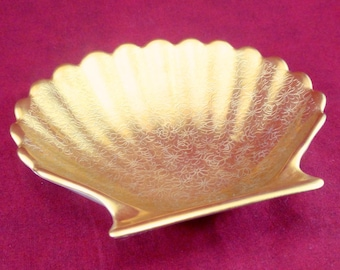Small gold seashell dish with floral engraving