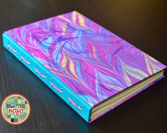 "Wonderful handmade journal with ""the robe"" stitch, marbled cover."