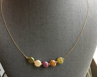 Multicolor freshwater pearls in unique disk shapes on gold tone wire
