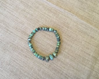 African turquoise rondelle beads stretch bracelet.