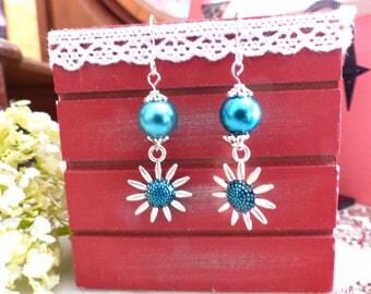 Pair of flower and blue pearl earrings